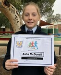 Asha_with_her_record_certificate.jpg