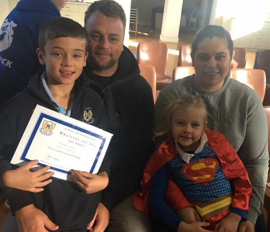 Oliver & Savannah Atfield with mum and dad
